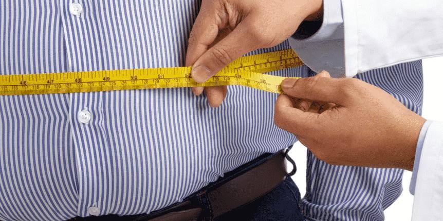 Man looking at weight