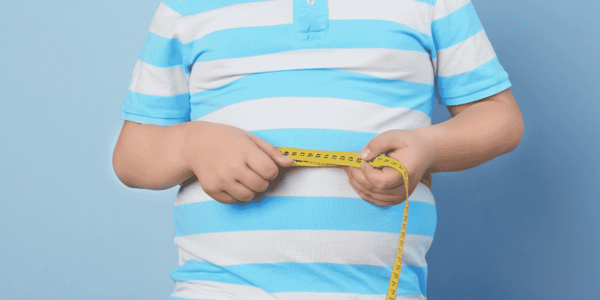 child weighing himself